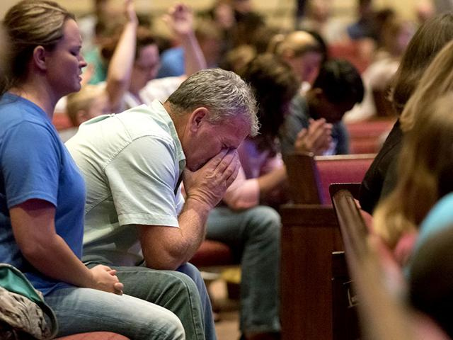 Corey Groce sits during a prayer vigil at Redemption Point Church for the victims of the shootings at a recruiting center and another US military site a few miles apart in Chattanooga. 24-year-old Mohammad Youssef Abdulazeez attacked the two centers killing four US marines. (AP Photo)