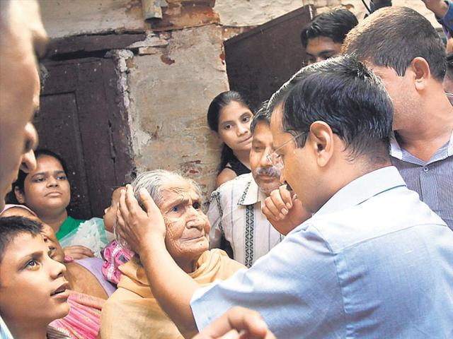 Delhi chief minister Arvind Kejriwal visits the victim's family in Anand Parbat on Saturday. (Arun Sharma/HT Photo)