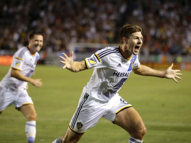 Los Angeles Galaxy's Steven Gerrard of England celebrates scoring his first goal for the team during the first half of an MLS soccer match against the San Jose Earthquakes, on July 17, 2015, in Carson, California. (AP Photo)