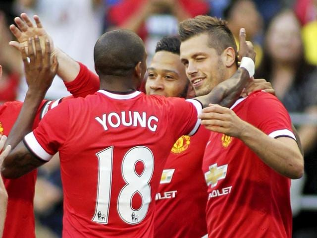 Manchester United's Morgan Schneiderlin, right, celebrates scoring a goal against Club America in United's pre-season friendly match at CenturyLink Field, Seattle, on July 17, 2015. (Reuters Photo)