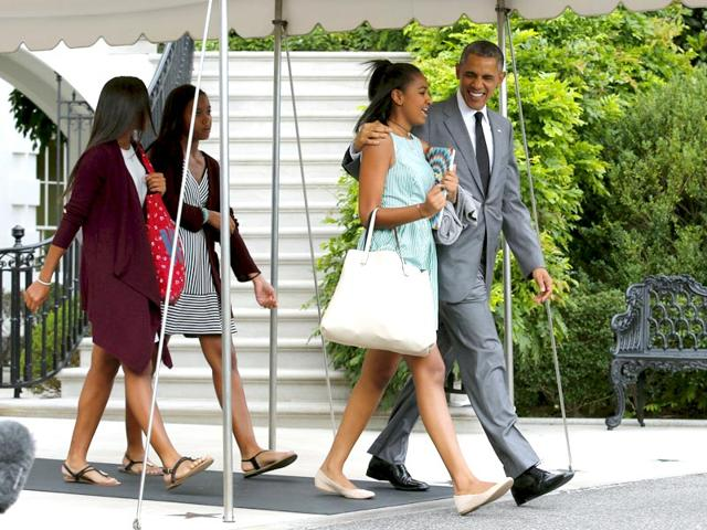 US President Barack Obama walks out with his daughter Sasha from the White House in Washington before departure to New York. President Obama spent the Friday night with his daughters in New York City. (Reuters Photo)