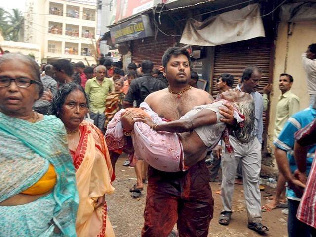 Pilgrims injured in a stampede while pulling Balabhadra Ratha chariots during Nabakalebar Rathayatra Festival, in Puri, Odisha on Saturday, July 18, 2015. (Photo by Arabinda Mahapatra)