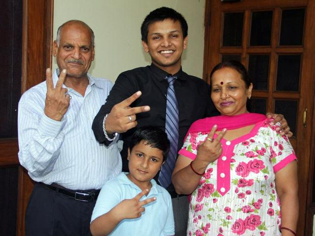 Sahil with his family at his residence in Ludhiana