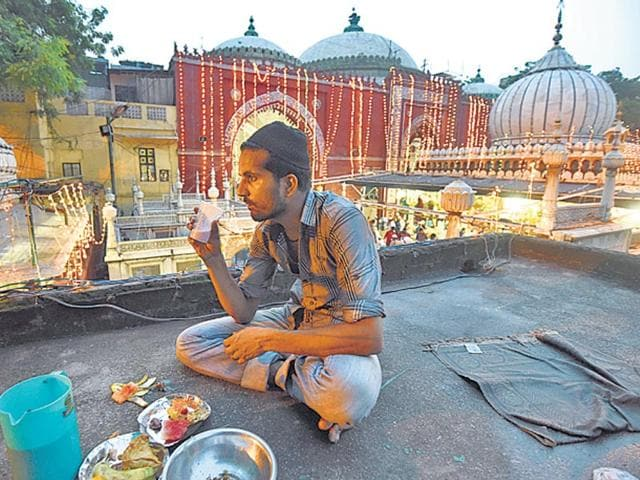 A man breaks his fast during Ramzan, that coincided with the Hindu Adhik Maas this year.