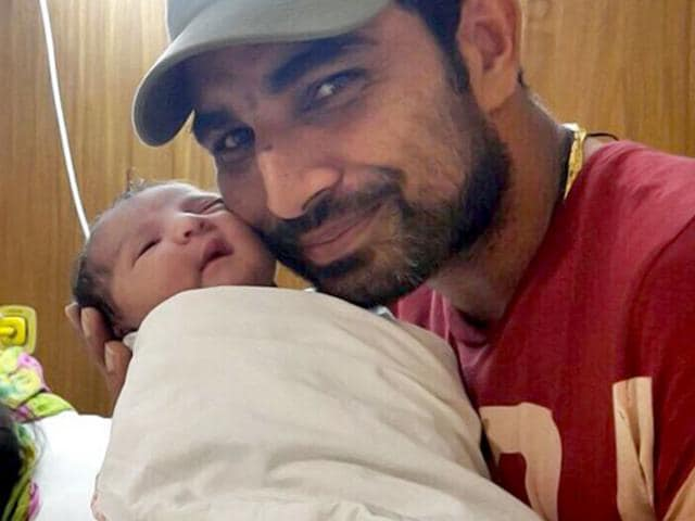 Indian cricketer Mohammad Shami with his baby daughter born on July 17, 2015. (Photo: Facebook.com/CircleofCricket.MDShami)