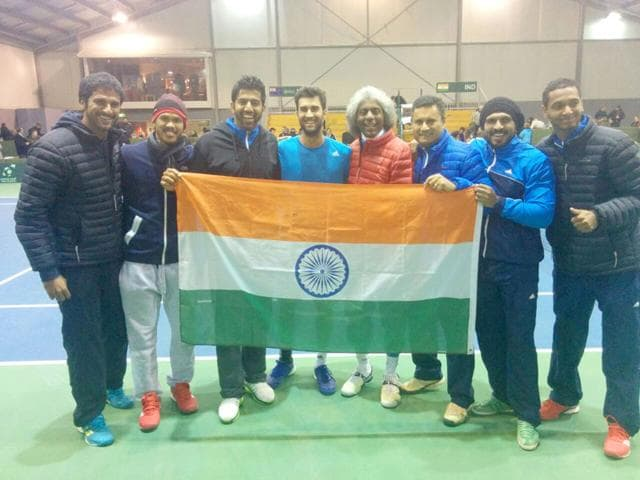 The victorious Indian Davis Cup team celebrates their 3-2 win over New Zealand in the Asia Oceania Group I tie, at Christchurch, New Zealand, on July 19, 2015. Second from left are players Somdev Devvarman, Rohan Bopanna, Yuki Bhambri, and team captain Anand Amritraj. (PTI Photo)