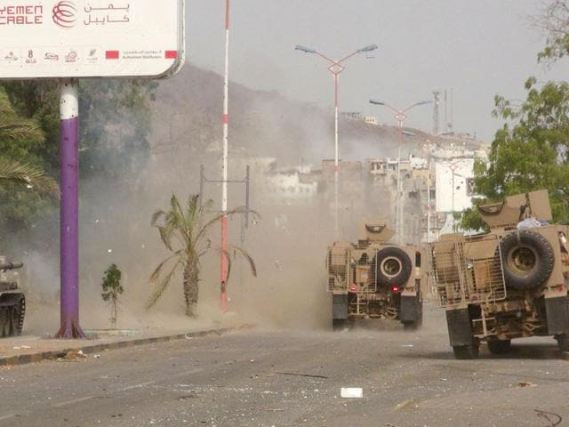 Military vehicles of the Southern Resistance fighters move during clashes with Houthi fighters on a street in Aden on July 17, 2015. (Reuters Photo)
