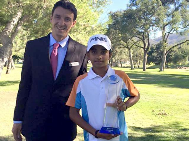 10-year-old Shubham Jaglan with the Junior World Golf Championship winner's trophy. (Photo: Facebook.com/shubham.jaglan.54)
