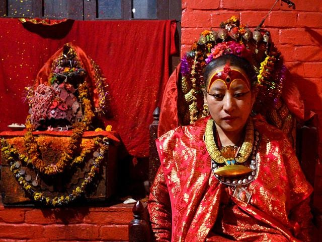 """Dhana Kumari Bajracharya, the longest reigning Kumari of Nepal, sits in her quarters in Kathmandu. When a massive earthquake struck Nepal in April, the country's longest-reigning """"living goddess"""", Dhana Kumari Bajracharya, left her quarters for the first time in three decades as tremors reduced nearby temples to rubble. (AFP Photo)"""