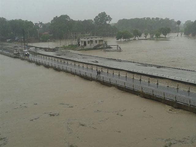Road on NH 69 near Budhni swept away on Tuesday due to heavy rainfall. (Mahendra Thakur/HT)