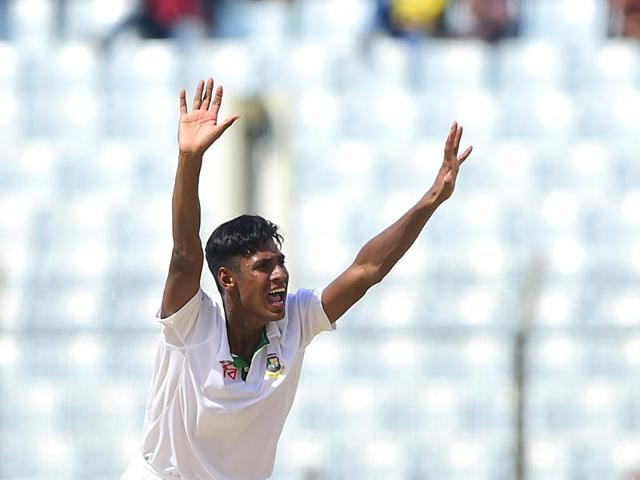 Mustafizur Rahman appeals successfully for leg before wicket against Jean-Paul Duminy on the first day of the first Test between Bangladesh and South Africa at the Zahur Ahmed Chowdhury Stadium in Chittagong on July 21, 2015. (AFP Photo)