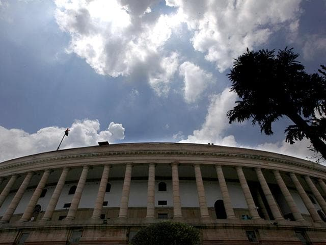 Cloud hover over the Parliament house on the opening day of the monsoon session, in New Delhi, India, on Tuesday, July 21, 2015. A united opposition disrupted proceedings in Rajya Sabha and forced adjournment over the Lalit Modi and Vyapam issues. (Photo by Arvind Yadav/ Hindustan Times)