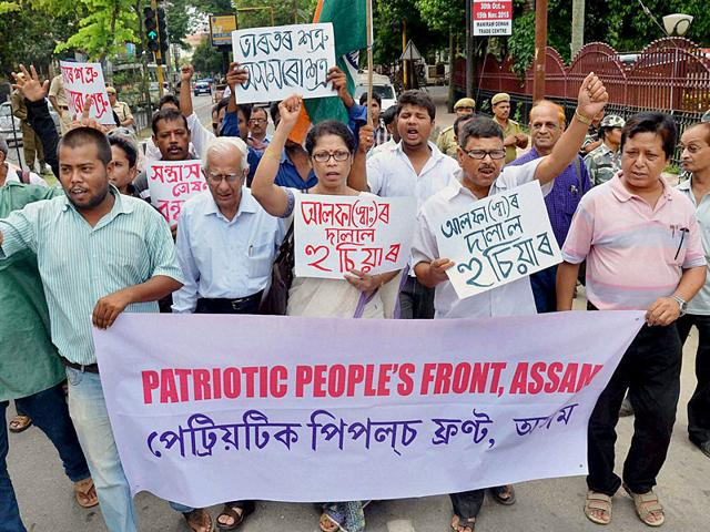Activists in Guwahati walk with the banner of Patriotic People's Front of Assam, protesting against Ulfa militants who have targeted civilians in the state. (PTI Photo)
