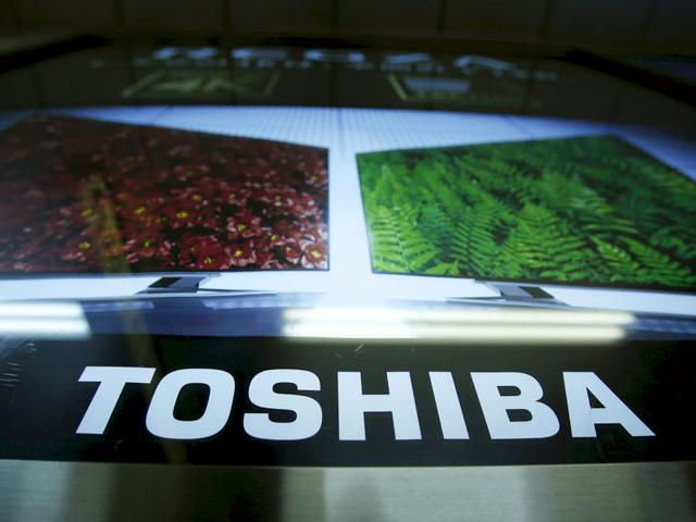 Japan's electronics giant Toshiba president Hisao Tanaka interacts with the press at the company's headquarters in Tokyo. (AFP File Photo)