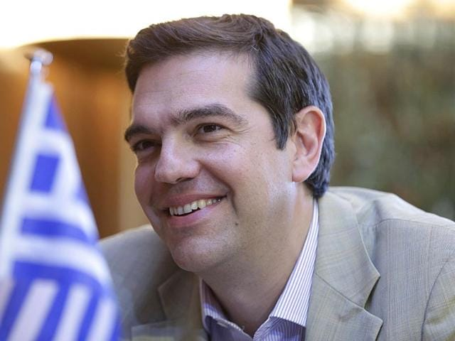 Greece-s-Prime-Minister-Alexis-Tsipras-prepares-for-a-TV-interview-at-the-State-Television-ERT-in-Athens-AP-Photo