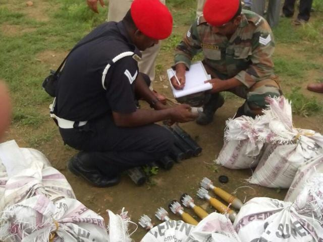 Army personnel examining unexploded mortar shells recovered near Ambala-Delhi railway line near Shahbad Markanda town, 25 km from Kurukshetra, on Wednesday. HT Photo