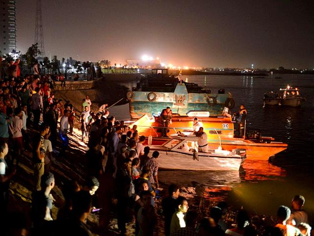 Police boats search for victims of a ferry boat accident on the River Nile in the Warraq area of Giza. At least 15 people drowned when a small boat collided with a barge and capsized on the Nile River near Cairo on Wednesday night, Egypt's interior ministry said (REUTERS Photo)