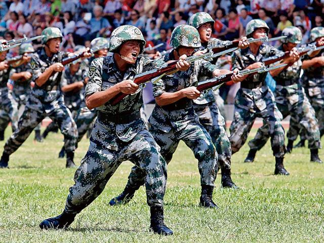The People's Liberation Army previously used Liberation shoes which were traditionally in dark green or camouflage colour. (Reuters)