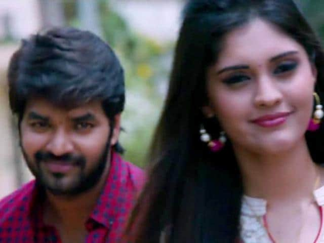 Jai and Surabhi in a still from the new film, Pugazh.