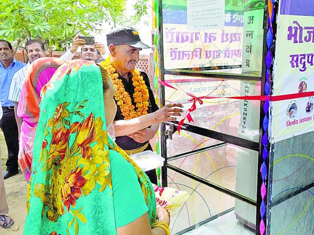The refrigerator to store surplus food was inagurated at Shri Gopal Nagar in Jaipur on Wednesday. HT Photo