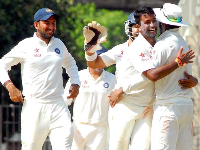 Pragyan Ojha picked up 5/85, while legspinner Amit Mishra had figures of 3/55 in Australia A's first innings in Chennai. (PTI Photo)