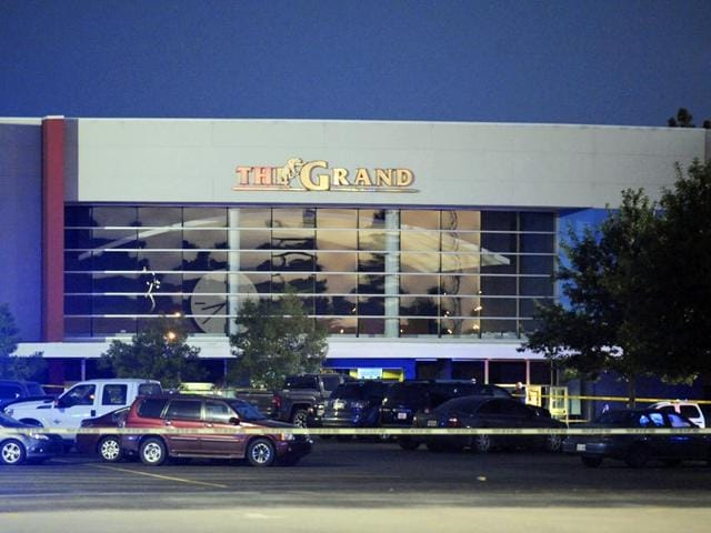 The Grand Theatre sealed by police following a deadly shooting on Thursday. (AP Photo)