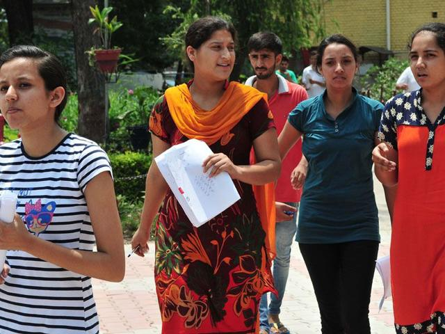 Candidates after appearing for the AIPMT retest at a centre in Chandigarh on Saturday. Keshav Singh/HT