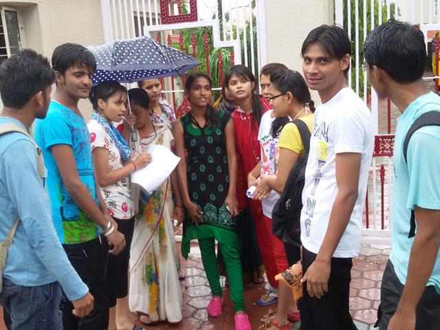 Aspirants who were denied entry at the AIPMT exam centre at Sagar Public School due to late arrival because of rain in Bhopal on Saturday. (Neeraj Santoshi/HT)