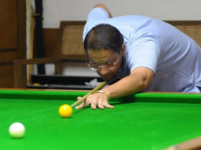 Amar Meet Singh in action during the billiards and snooker championship at Chandigarh Club, Sector 1, on Friday. Keshav Singh/HT