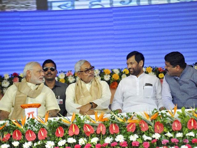 Prime Minister Narendra Modi with Bihar chief minister Nitish Kumar and union ministers Ram Vilas Paswan and Dharmendra Pradhan at a function for the launch of a number of government schemes in Patna on Saturday. (PTI Photo)