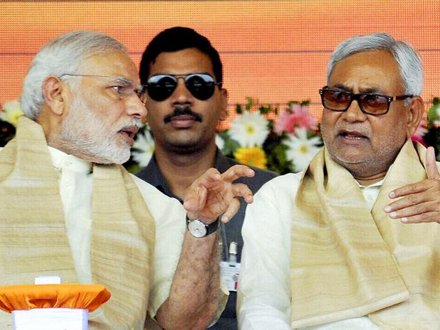 Prime Minister Narendra Modi with Bihar chief minister Nitish Kumar at a function for the launch of a number of government schemes in Patna on Saturday. (PTI Photo)