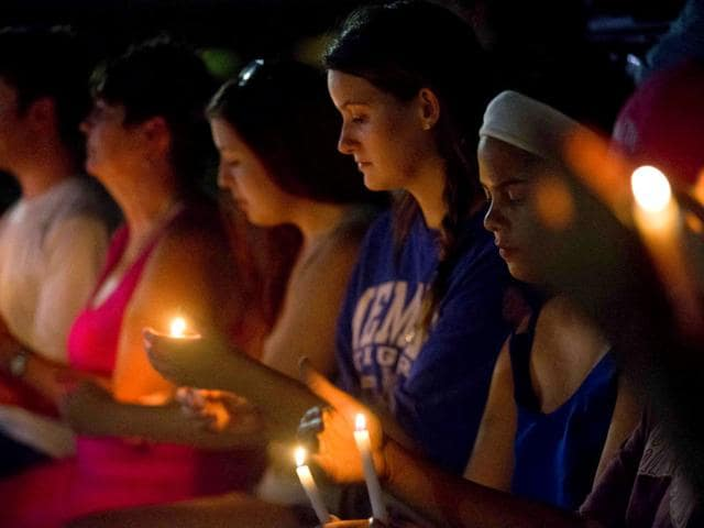 Mourners attend a vigil to honour the victims of Thursday night's shooting at The Grand 16 theatre, in Lafayette, La. (AP Photo)