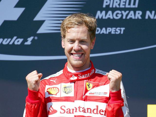Ferrari Formula One driver Sebastian Vettel of Germany celebrates winning the Hungarian Grand Prix at the Hungaroring circuit, near Budapest, Hungary, on July 26, 2015. (Reuters Photo)