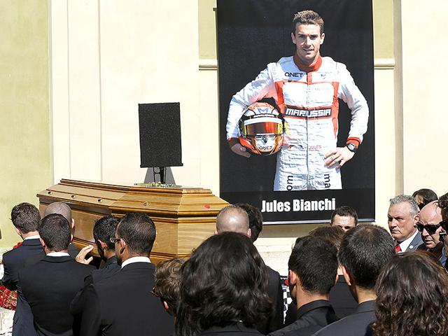 Pallbearers carry the casket of French Formula One driver Jules Bianchi into Sainte Reparate Cathedral during his funeral in Nice, France, on July 21, 2015. Bianchi's family will be present at the Hungarian Grand Prix on July 26, 2015 to pay silent tribute to the deceased driver. (AP Photo)