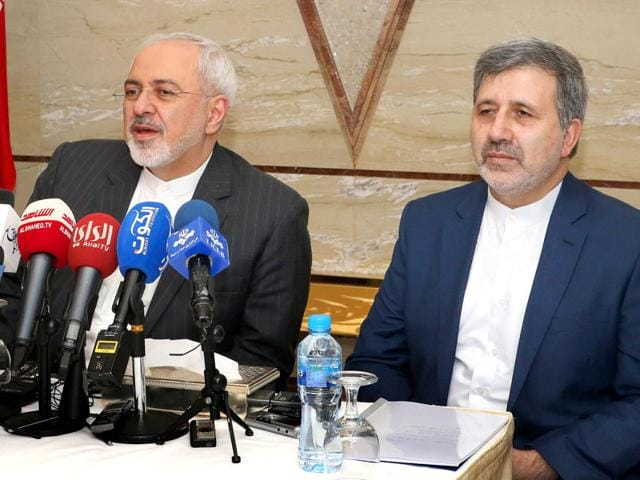 Iran's foreign minister Mohammad Javad Zarif (L) attends a press conference with Iranian ambassador to Kuwait Ali Reza Enayati in Kuwait City. (AFP Photo)