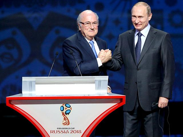 Outgoing Fifa president Sepp Blatter, left, shakes hands with Russian President Vladimir Putin ahead of the preliminary draw for the 2018 Fifa World Cup qualifiers at the Konstantin Palace in Saint Petersburg, on July 25, 2015. (AFP Photo)