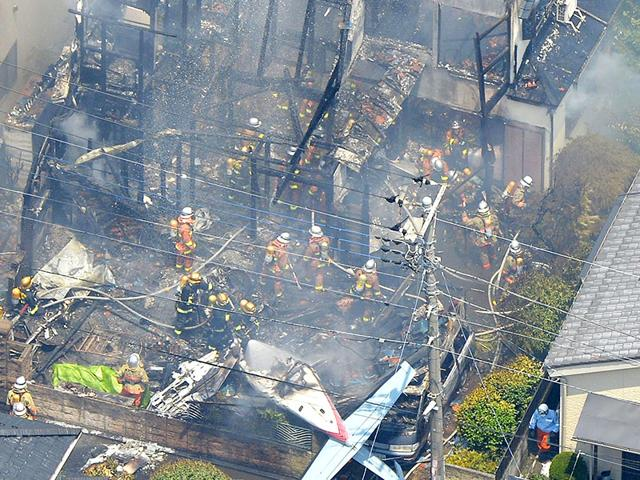 An aerial view shows debris of a crashed light plane (bottom C) and burning houses are seen after the plane went down in a residential area and burst into flames, in Chofu, outskirt of Tokyo. (Reuters)