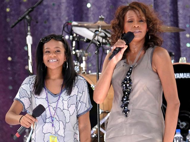 In this Sept. 1, 2009 file photo, singer Whitney Houston, right, sings with her daughter Bobbi Kristina Brown during a performance on