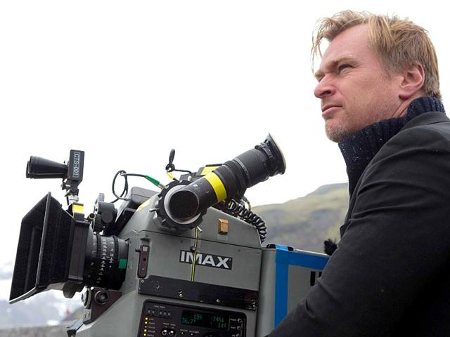 Christopher Nolan with his weapon of choice, the IMAX camera. (Twitter)