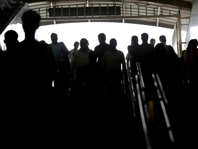 Commuters walk inside a metro station in New Delhi. India's population is set to pass China's in size around 2022, according to the United Nations report released Wednesday, July 29. (AP Photo/Saurabh Das)