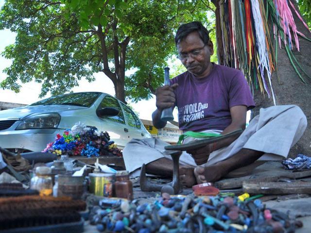 Ram Badsish mending shoes at Sector 27 in Chandigarh on Sunday. Karun Sharma/HT