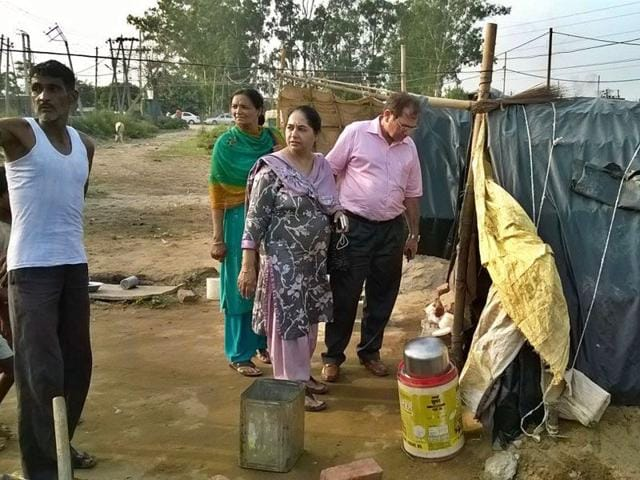 Director, health and family welfare, Punjab, Dr Bhag Mal, along with civil surgeon Dr Renu Chhatwal, inspecting Prem Nagar area on Tajpur road in Ludhiana on Sunday. HT Photo