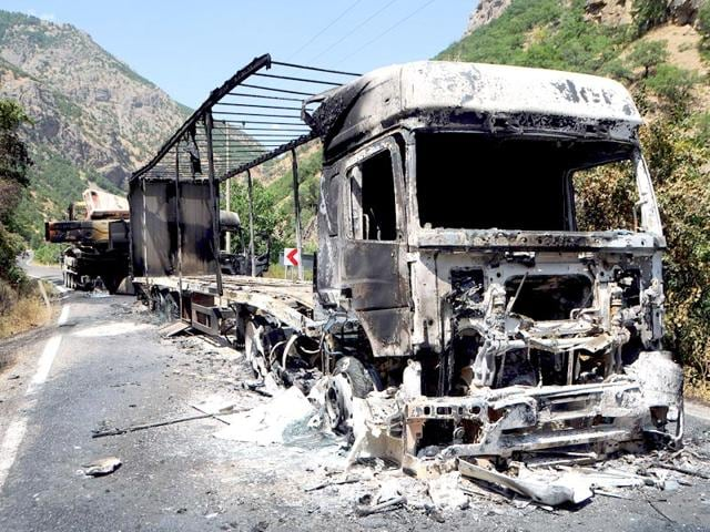 A picture shows two burnt trucks reportedly set on fire by Kurdistan Workers' Party (PKK) militants in Tunceli, eastern Turkey, on August 2, 2015. (Representative Photo, AFP)