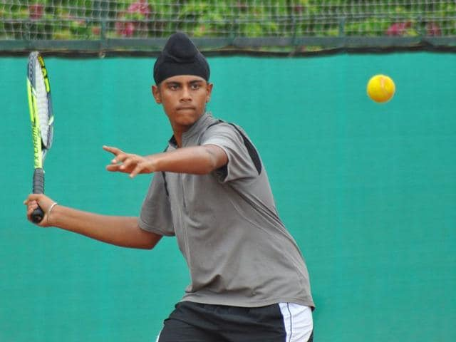 Savneet Singh Bajwa in action during the final qualifying rounds of the boys' under-16 age group in the AITA Talent Series tennis tournament at Sunrise Tennis Academy, Chandigarh Club on Sunday. Karun Sharma/HT