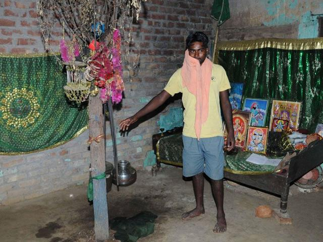 Son of witchcraft performer Sukkho in the woman's 'prayer room' at Kamboh village in Tarn Taran district.