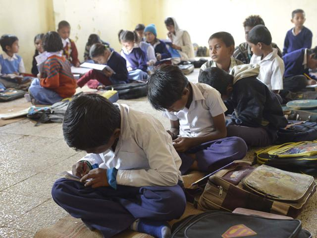 Students study at a government school in Bhopal. (HT file/Mujeeb Faruqui)