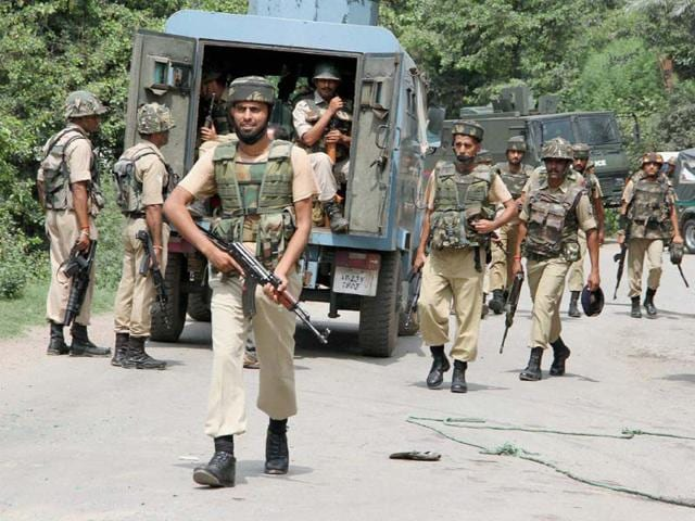 Security forces during a terrorist attack on a convoy of Border Security Force (BSF) on the Jammu-Srinagar National Highway in Udhampur district of Jammu and Kashmir on Wednesday. (PTI Photo)