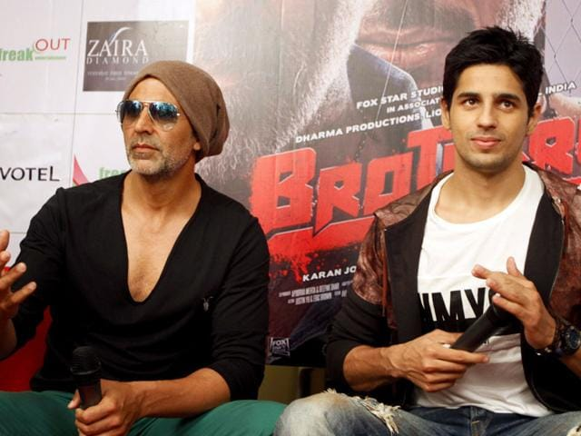Actors Akshay Kumar, left, and Sidharth Malhotra attend a press conference of their upcoming movie Brothers in Ahmadabad. The film is scheduled to release on August 14. (AP Photo)