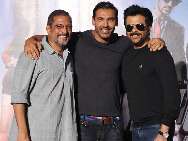 Left to right: Actors Nana Patekar, John Abraham and Anil Kapoor perform during the promotion of the upcoming Hindi film Welcomw Back directed by Anees Bazmee in Mumbai. (AFP Photo)