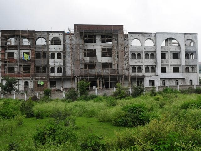 The incomplete building of Haj House in Bhopal. Though the Haj House was announced during the Congress regime in 2003, the project could not take off due to legal hassles over the land that was allotted for it. (Mujeeb Faruqui/HT photo)